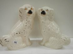 "A pair of early 20th century Staffordshire dogs, 14"" tall (one has crack as shown in image,"