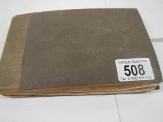 An old autograph book containing aircraft pictures and Kensitas cigarette cards,