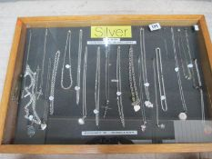 A display case of mainly silver pendants, chains etc., (this lot is buyer collect only).