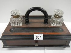 A good early 20th century desk stand with 2 inkwells and single drawer to base.