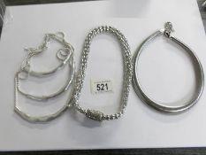 Three white metal necklaces in the style of Butler and Wilson.