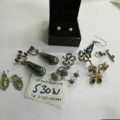 7 pairs of earrings and 3 odd earrings.