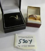 An unusual adjustable ring and one other.