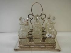 A good silver plate 6 bottle cruet.