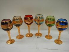 A set of 6 Bohemian coloured glasses with gilding (in good condition).