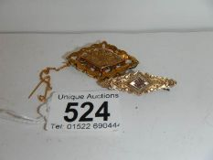 2 9ct gold brooches.