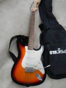 A Starsound guitar with small amp.