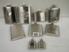 9 20th century hip flasks.