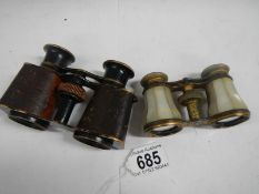 2 pairs of vintage opera glasses, one mother of pearl and the other brass with leather covering.