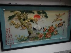 A large retro Chinese shell art design wall picture and an oval wall mirror.