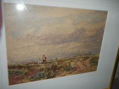 A framed and glazed early 20th century watercolour of a boy and girl flying a kite.