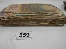 Approximately 120 old bank notes (well used).