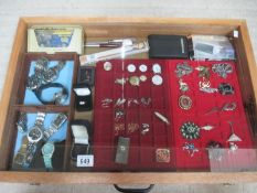 A display case containing assorted jewellery and watches etc., (this lot is buyer collect only).