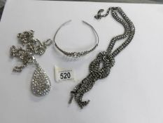 A quality paste long necklace by Kirsh of London together with a vintage tiara and a pear shaped