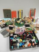 A mixed lot of vintage reels of cotton, buttons etc.
