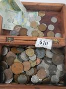 A mixed lot of assorted coins.