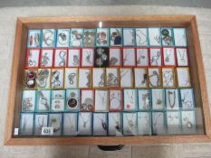 A display case containing in excess of 60 pieces of mainly silver pendants, rings, bracelets etc.