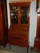 An Edwardian inlaid bureau bookcase, in good condition.