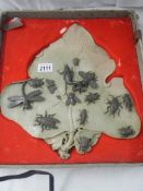 """An early 20th century carved soapstone leaf with carved soapstone insects on top, 14.5"""" x 13""""."""