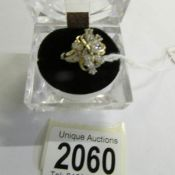 An oval cut white stone set cluster ring in 14ct gold hall marked, size P.