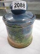 An old Royal Doulton biscuit barrel.