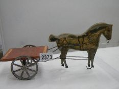 """An early 20th century toy pull along horse and cart, 13"""" long."""