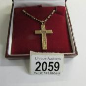 A rose gold cross dated Chester 1932, chased gold work to front with attached 9ct gold chain, 9.
