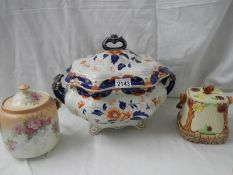 """A large tureen (13"""" wide x 11"""" high) and 2 biscuit barrels."""