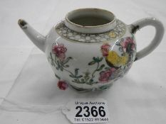 An 18th century Chinese teapot, missing lid and a/f.
