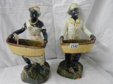 """A pair of majolica style figures, 14.5"""" tall. Repairs to arms and basket on one figure."""