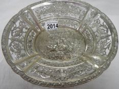 A foreign silver embossed dish, approximately 308 grams.