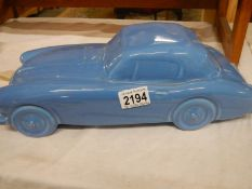 A large Dartmouth pottery model of an Austin Healey car, a/f.