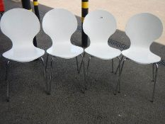 A set of 4 retro style chairs.