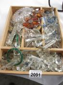 A large tray of crystal and glass chandelier droppers.
