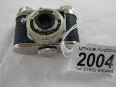 A miniature spy camera.