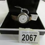 An early 20th century ladies watch in silver set with Neillo work around dial, in working order.