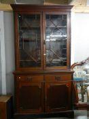 A Victorian mahogany astragal glazed bookcase.