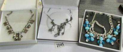 2 dazzling vintage necklace and a further necklace in a designer style.