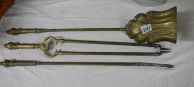 "A set of Victorian reeded brass fire irons, 25"" long."