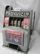 A mid 20th century Bonanza 4 roll one arm bandit in working order.
