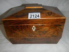 A figured mahogany caddy shaped box.