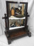 A Victorian mahogany toilet mirror in good condition.