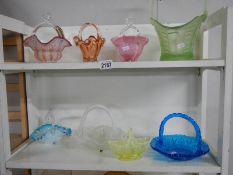 8 art glass baskets.