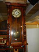 A Victorian mahogany Vienna wall clock.