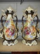 A pair of Staffordshire vases, some crazing and one handle has repair.