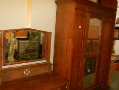 An oak wardrobe and dressing table.