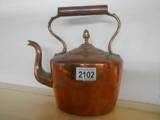 A Victorian copper kettle with acorn knob to lid and bronze handle.