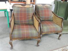 A pair of Bergere arm chairs.