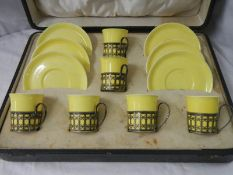 A cased set of 6 Shelley cups and saucers with hall marked silver cup holders.