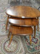 A nest of 3 ercol tables.